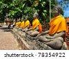 Abreast Buddha Statue - stock photo