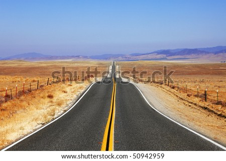 Abrupt bends of road on open spaces of the Californian steppes - stock photo