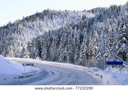 Abrupt turn of mountain road in the winter ( island Sakhalin) - stock photo
