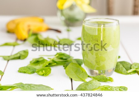 Absolutely Amazing Tasty Green Avocado Shake or Smoothie, Made with Fresh Avocados, Banana, Lemon Juice and Non Dairy Milk on Light Wooden Background, Raw Food, Vegan Drink, Vegan Food Conception - stock photo