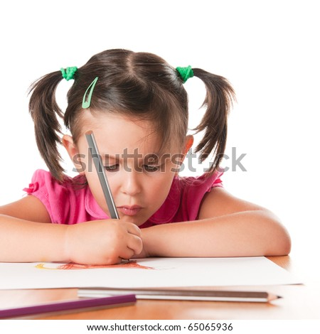 Absorbed little girl drawing with pencils isolated on white background - stock photo