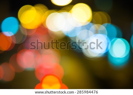 abstact blur circular bokeh color of Evening traffic jam on road in city. - stock photo
