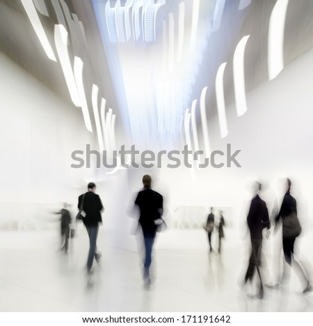 abstakt image of people in the lobby of a modern art center with a blurred background - stock photo