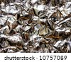 abstract aluminum crinkled foil background - stock photo