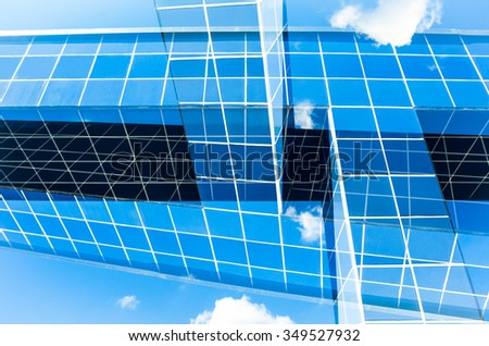 abstract architecture in front of cloudy blue sky double exposure