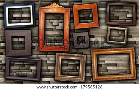 abstract arrangement of wooden  frames on grungy wall  - stock photo