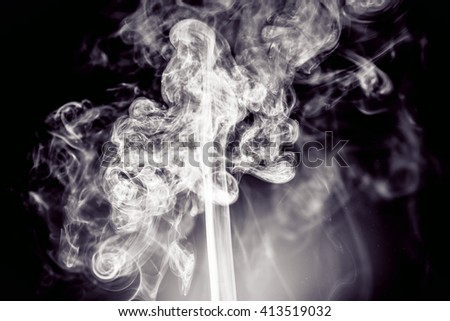 Abstract art. Grey smoke from the incense on a white background. Background for Halloween. Texture fog. Design element. The concept of aromatherapy. - stock photo