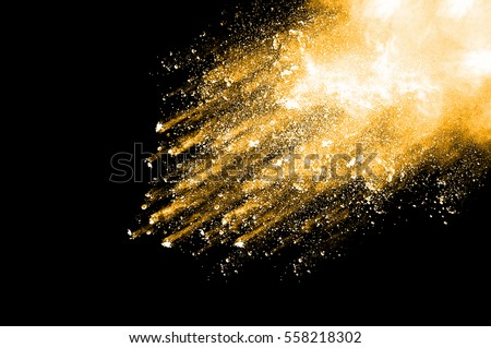 Abstract art orange powder on black background. Frozen abstract movement of dust explosion orange colors on black background. Stop the movement of orange powder on dark background.