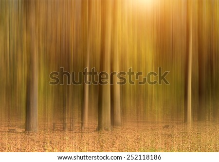 Abstract autumn forest in motion blur - stock photo