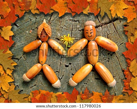 Abstract autumn scene - two people made from acorn - stock photo