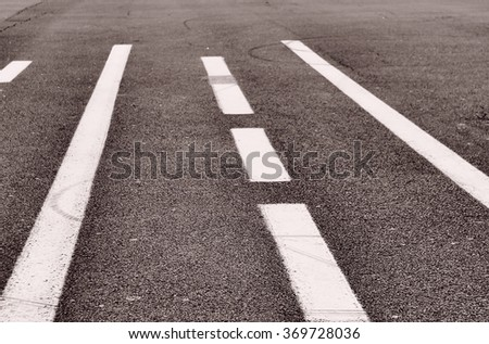 abstract background - asphalt road with road marking close up, vintage effect photo