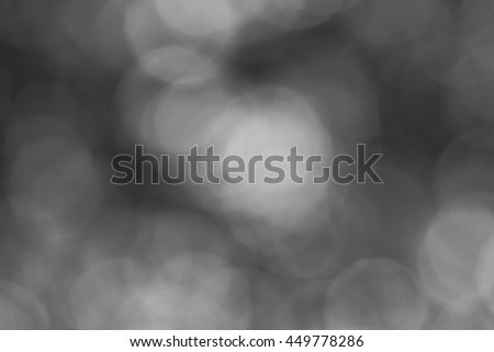 abstract background black and white bokeh circles - stock photo