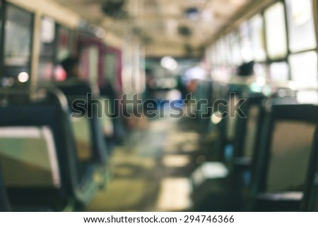 Abstract background blur people on the bus at night in Thailand. The last bus at night waiting for last passenger to go with them. Vintage tone - stock photo