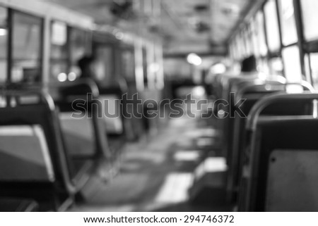 Abstract background blur people on the bus at night in Thailand. The last bus at night waiting for last passenger to go with them. Black and White tone - stock photo