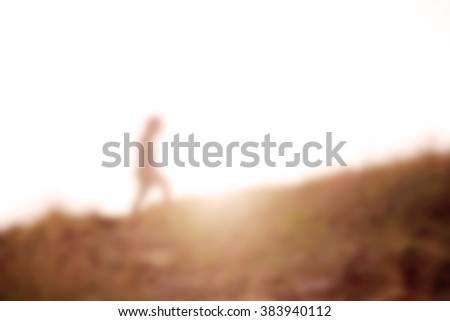 abstract background blur with man and sunset - stock photo