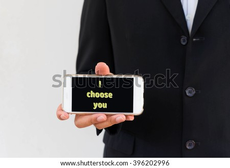abstract background business man show message on smartphone said i choose you