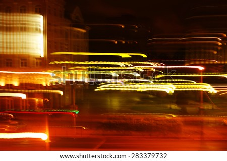 abstract background, city night lights blurred in motion - stock photo