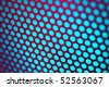 Abstract background: Colorful perforated metal sheet grid. - stock photo