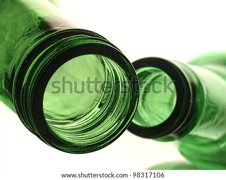 Abstract background design made up of  colored  empty  beer bottles. - stock photo
