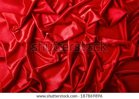 Abstract background, drapery red fabric. Crumpled cloth, folds of fabric.