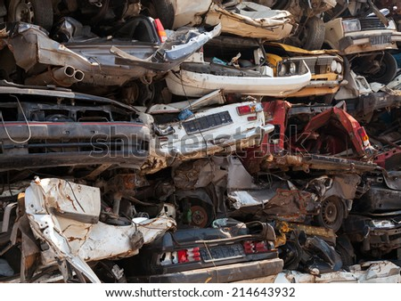 Abstract background, dump of stacked cars in junkyard - stock photo