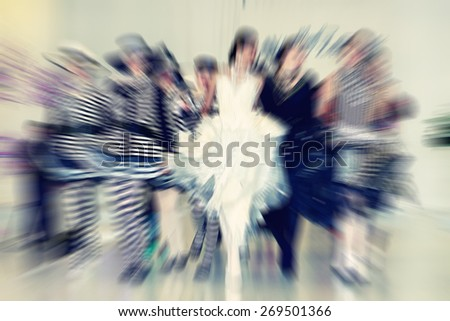 Abstract background - fashion models on catwalk - radial zoom blur effect defocusing filter applied, with vintage instagram look. - stock photo