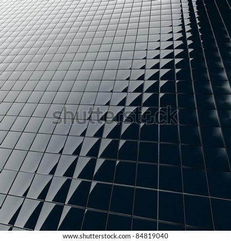 Abstract background from a modern construction material from black plastic - stock photo