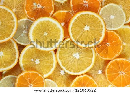 Abstract background from citrus fruit (orange, tangerine, lemon) - stock photo