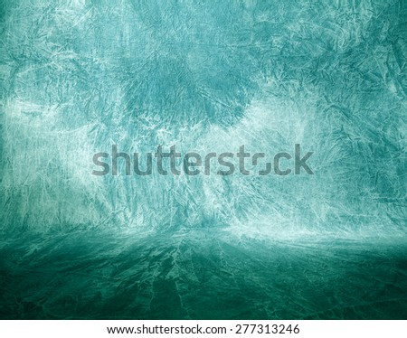 Abstract background (green fabric)