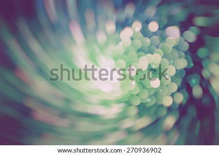 Abstract background holidays lights in motion blur vintage image - stock photo