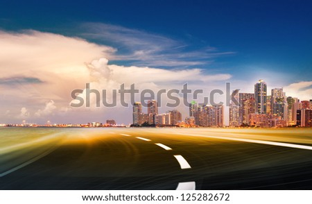 Abstract background illustration of fast highway road motion going to modern city at sunset or sunrise. - stock photo