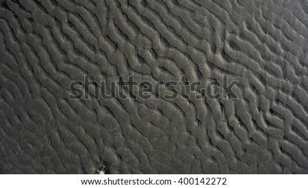 Abstract background in black and white on sand
