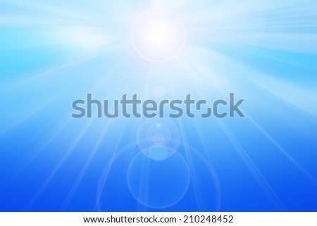 Abstract background in blue tones. Sun with lens flare.
