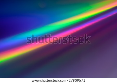 Abstract background in Rainbow colors reflection on the surface of a DVD/CD