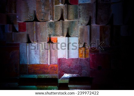 abstract background in the form of illuminated old tiles on the wall