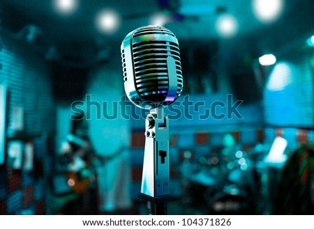 Abstract background live music with vintage microphone and musicians - stock photo
