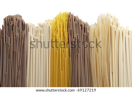 Abstract background made of different types of spaghetti on white background - stock photo