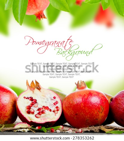 Abstract background made of pomegranate and leaves - stock photo