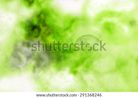 Abstract background of a planet hidden in a green and yellow nebula - stock photo