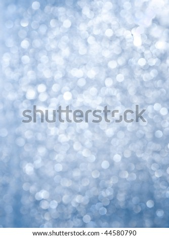 Abstract background of blue glittering lights - stock photo