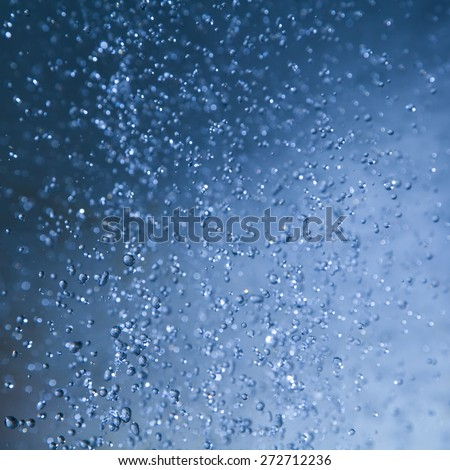 Abstract background of blue water drops. - stock photo