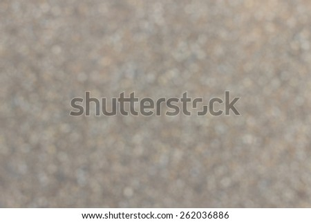 Abstract background of blurred various pebble stones surface. - stock photo