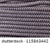Abstract background of braided interwoven dark cord - stock photo