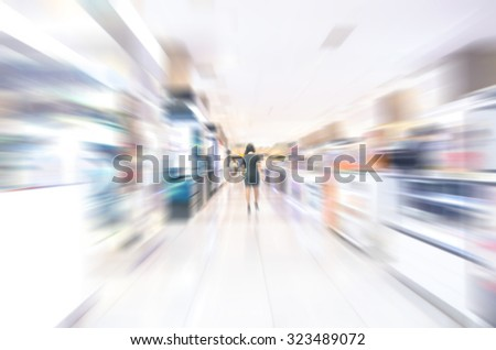 Abstract background of business people in blurred motion walking. Business people walking in luxurious shop store corridor - stock photo