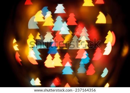Abstract Background of Christmas Tree Shape Bokeh Lights - stock photo