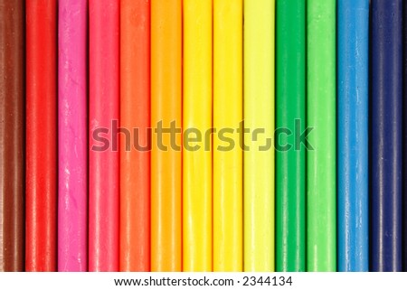 Abstract background of color crayons without their paper cover.