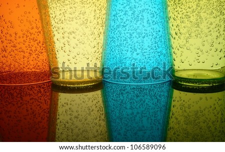 Abstract background of colored glasses of plastic - stock photo