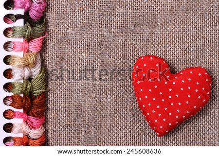 Abstract background of colored threads for cross stitch - stock photo