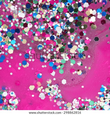 Abstract background of colorful glitters on the pink background - stock photo