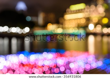 Abstract background of Defocused Lights of New Year decorations in Singapore. Blur Light, Out of Focus, vivid Bohek, Holidays light. Colorful holiday urban cityscape bokeh background. - stock photo